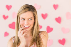 Woman Looking Away With Heart Shaped Papers Against Pink Backgro Stock Photos
