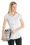 Woman Looking Away While Holding Film Reel And Slate Royalty Free Stock Photos