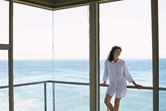 Woman Looking Away While Leaning On Railing In Balcony Stock Images