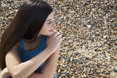 Woman Looking Away While Sitting At Beach Royalty Free Stock Images