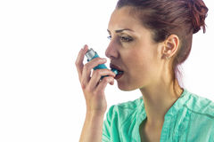Woman looking away while using asthma inhaler Stock Photography