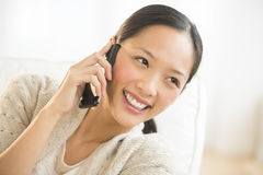 Woman Looking Away While Using Smart Phone Stock Photos