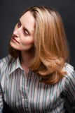 Woman looking away wearing striped shirt Royalty Free Stock Photo