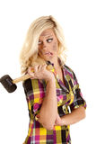 Woman looking back with rubber mallet Stock Photos