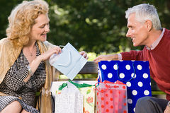 Woman looking in bag at gift from husband Royalty Free Stock Photography