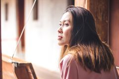 Woman looking at the balcony. royalty free stock images