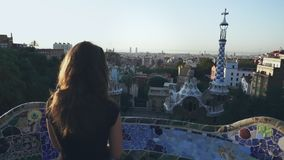 Woman looking at Barcelona cityscape on viewing platform. World traveling. Young woman looking at Barcelona cityscape on viewing platform. Beautiful girl in Park stock video