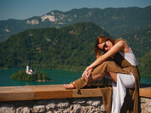 Woman looking on a beautiful Bled lake, Slovenia Stock Photography