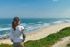 Woman looking at beautiful ocean view Royalty Free Stock Photography