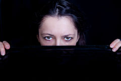 Woman looking from behind a veil Royalty Free Stock Images