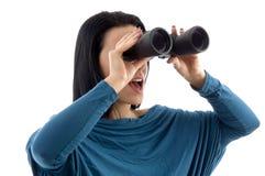 Woman looking through binocular Royalty Free Stock Photography