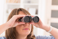 Woman looking through binocular Stock Photos
