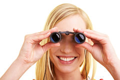 Woman looking through binoculars Stock Image
