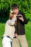 Woman looking through binoculars Stock Photography