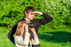 Woman looking through binoculars Royalty Free Stock Photography