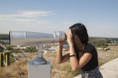 Woman looking through binoculars. In a natural river Royalty Free Stock Photos