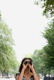 Woman looking through binoculars Stock Image