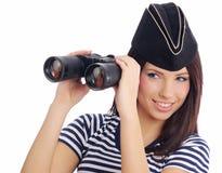 Woman looking through binoculars Royalty Free Stock Photos