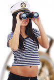 Woman looking through binoculars Stock Photos