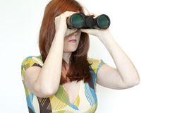 Woman looking through binoculars Royalty Free Stock Image