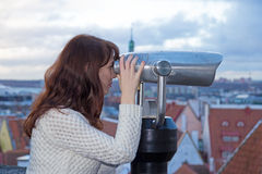 Woman looking in binoculars - Tallinn, Estonia Royalty Free Stock Photos