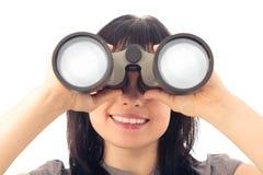 Woman Looking Through Binoculars. Young happy woman looking through binoculars Royalty Free Stock Photo