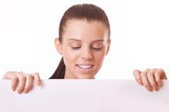 Woman looking at blank board Stock Image