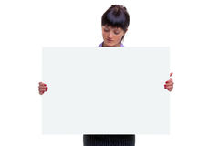 Woman looking at a blank sign Royalty Free Stock Image