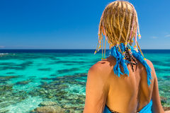 Woman looking blue sea Royalty Free Stock Images