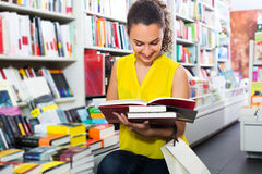 Woman looking at book Stock Image