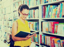 Woman looking at book Stock Photography