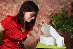 Woman looking in a box royalty free stock images