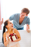 Woman looking on boy who made her surprise Royalty Free Stock Photo