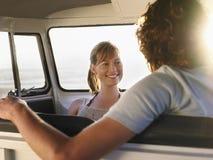 Woman Looking At Boyfriend In Campervan Royalty Free Stock Photos
