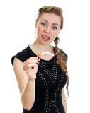 Woman looking at broken cigarette. Royalty Free Stock Photos