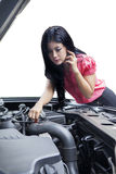 Woman looking the broken machine car Stock Photo