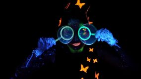 Woman looking through bubbles stock footage
