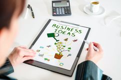 Business ideas concept on a clipboard. Woman looking at a business ideas concept Royalty Free Stock Photos