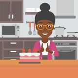 Woman looking at cake. Royalty Free Stock Images