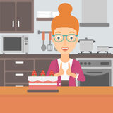 Woman looking at cake. Stock Image