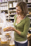 Woman looking at cakes Stock Photography