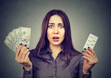 Shocked woman with pills and bills Stock Photos
