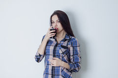 Woman looking at camera and drinking red wine Stock Photo