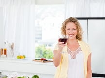 Woman looking at the camera with her drink of wine Royalty Free Stock Photos