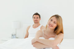 woman looking at the camera with her husband Stock Image