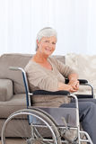 Woman looking at the camera in her wheelchair Royalty Free Stock Photography