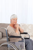 Woman looking at the camera in her wheelchair Royalty Free Stock Photos
