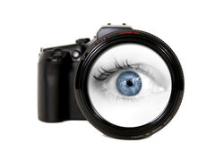 Woman Looking Through a Camera Lens stock photography