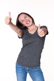 Woman looking at camera and showing thumbs up Royalty Free Stock Images