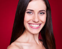 Woman looking at camera and smiling Stock Photography